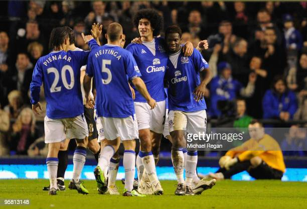 Louis Saha of Everton is congratulated by his team mates after scoring his team's second goal from a penalty during the Barclays Premier League match...