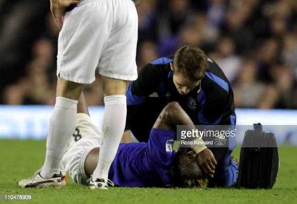Louis Saha of Everton receives treatment on the pitch during the Barclays Premier League match between Everton and Fulham at Goodison Park on March...