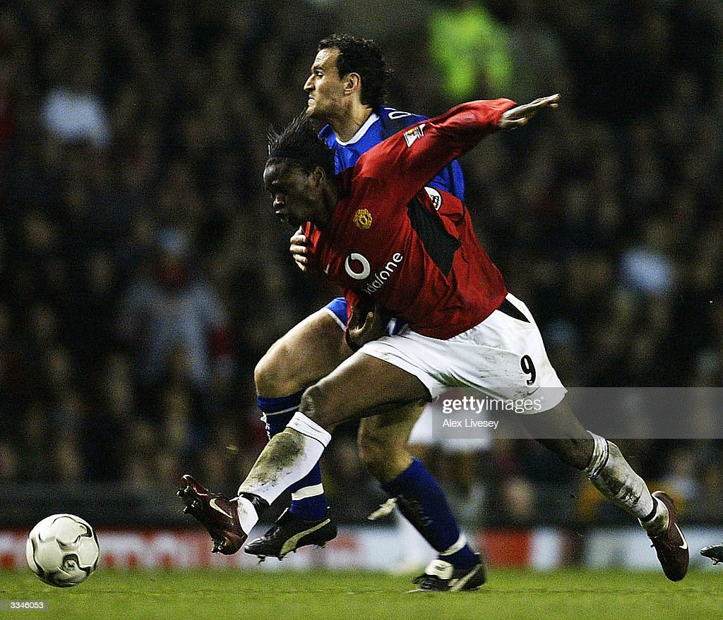 Louis Saha of Manchester United beats Nikos Dabizas of Leicester City during the FA Barclaycard Premiership match between Manchester United and Leicester City at Old Trafford on April 13, 2004 in Manchester, England.