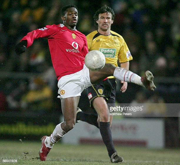 Louis Saha of Manchester United clashes with Darren Tinson of Burton Albion during the FA Cup Third Round match between Burton Albion and Manchester...