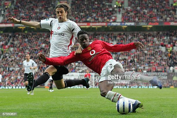 Louis Saha of Manchester United clashes with Gonzalo Sorondo of Charlton Athletic during the Barclays Premiership match between Manchester United and...