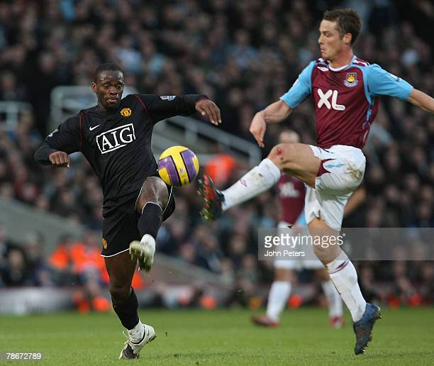 Louis Saha of Manchester United clashes with Scott Parker of West Ham United during the Barclays FA Premier League match between West Ham United and...