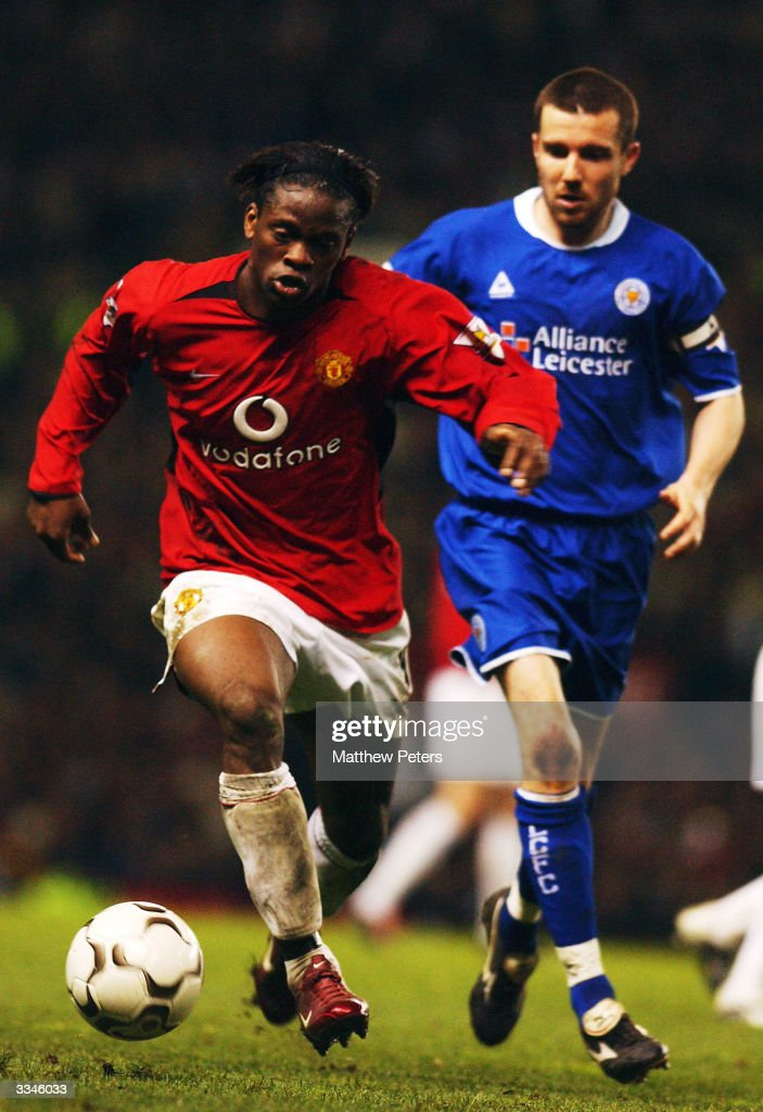 Louis Saha of Manchester United keeps the ball away from Muzzy Izzet of Leicester City during the FA Barclaycard Premiership match between Manchester United and Leicester City at Old Trafford on April 13, 2004 in Manchester, England.