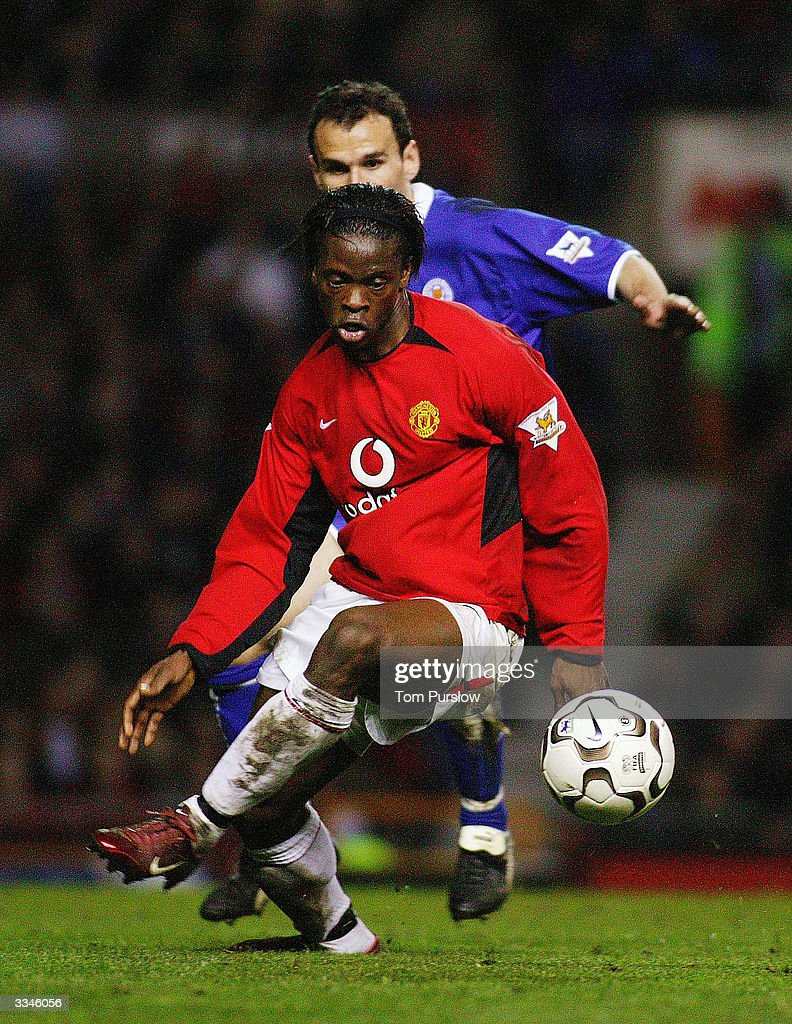 Louis Saha of Manchester United keeps the ball away from Nikos Dabizas of Leicester City during the FA Barclaycard Premiership match between Manchester United and Leicester City at Old Trafford on April 13, 2004 in Manchester, England.