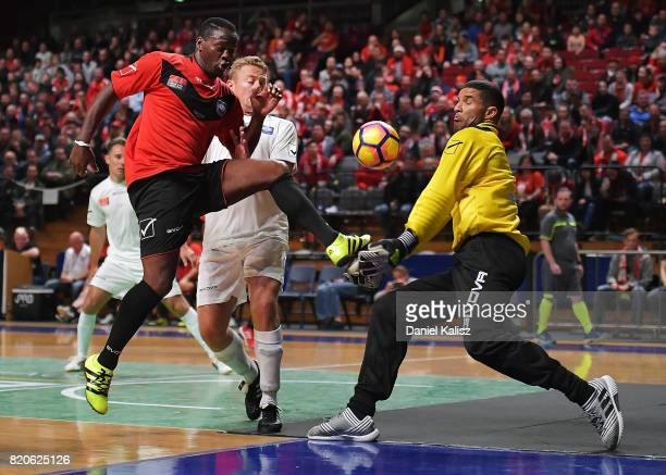 Louis Saha of Manchester United strikes the ball as David James goalkeeper for Liverpool attempts to save the ball during the match between the...