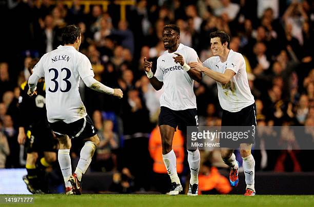 Louis Saha of Spurs is congratulated by teammates Ryan Nelsen and Gareth Bale after scoring his team's third goal during the FA Cup sixth round match...