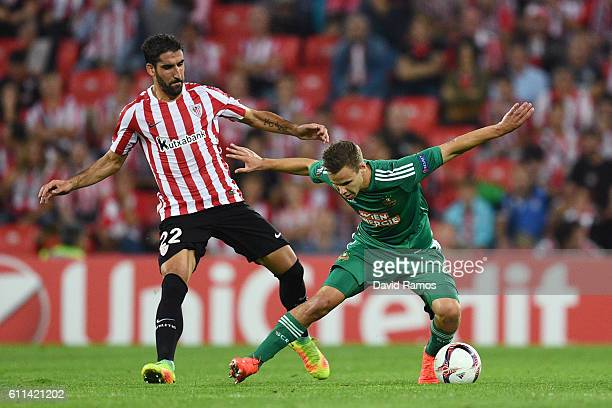 Louis Schaub of Rapid Vienna holds off the challenge from Raul Garcia of Athletic Bilbao during the UEFA Europa League group F match between Athletic...