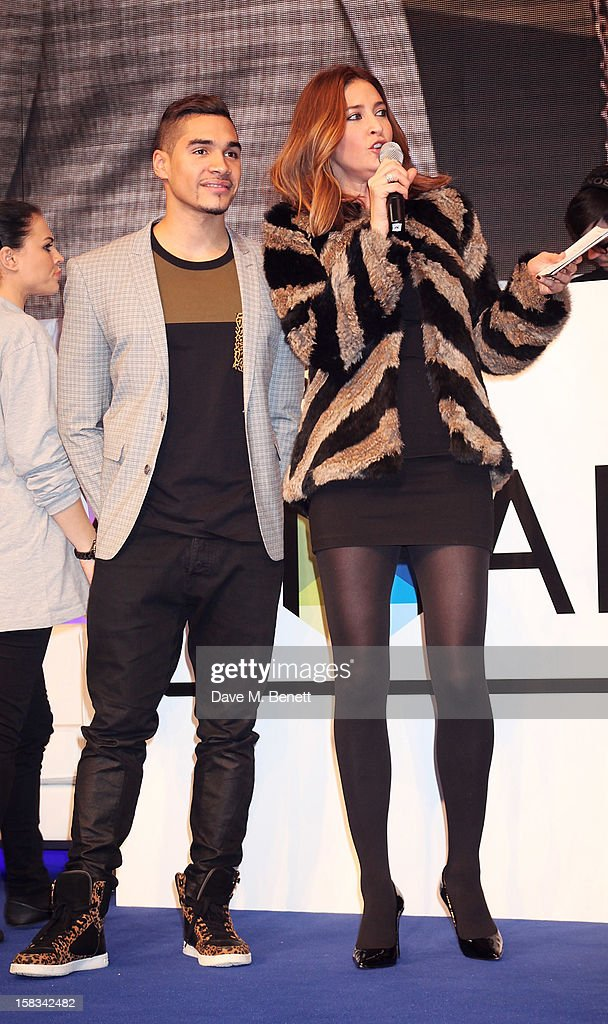 Louis Smith (L) and Lisa Snowdon attend the Samsung Smart TV Angry Birds Party at Westfield Stratford City on December 13, 2012 in London, England.