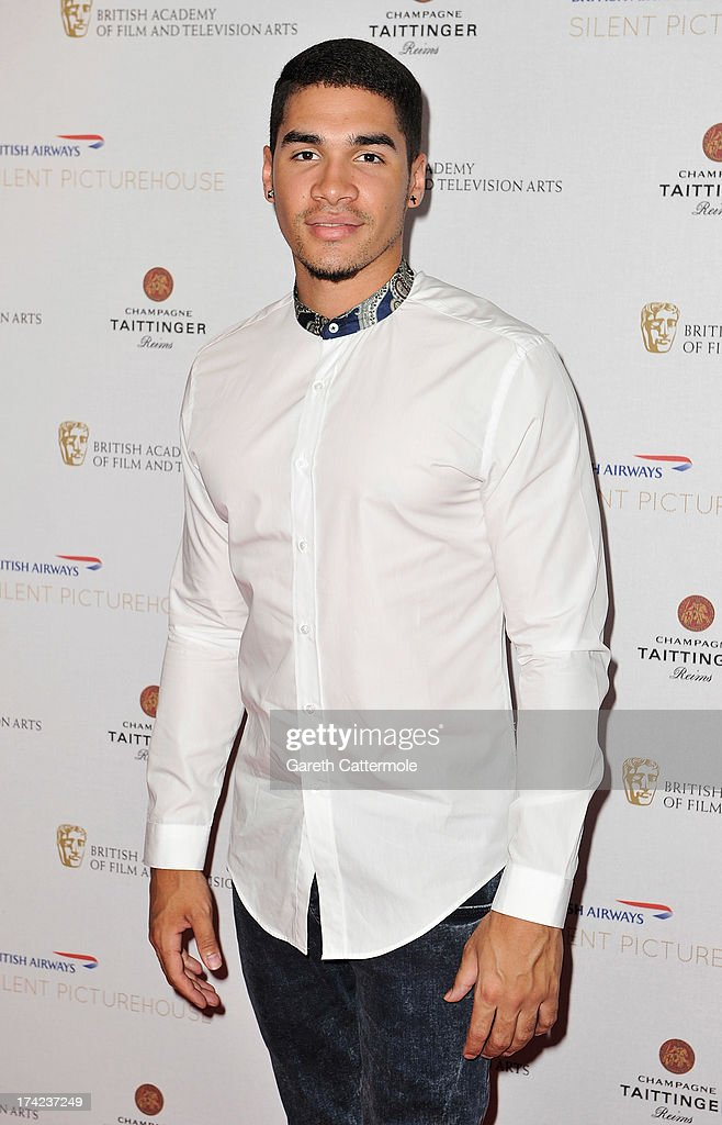 <a gi-track='captionPersonalityLinkClicked' href=/galleries/search?phrase=Louis+Smith+-+Gymnast&family=editorial&specificpeople=798756 ng-click='$event.stopPropagation()'>Louis Smith</a> attends the British Airways Silent Picturehouse launch at Vinopolis on July 22, 2013 in London, England.The pop-up film event shows movies that inspire travel.