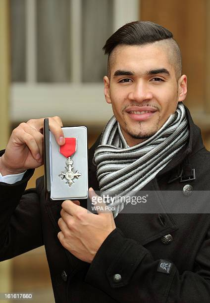 Louis Smith holds his Member of the British Empire medal after it was presented to him by Queen Elizabeth II at the Investiture Ceremony at...