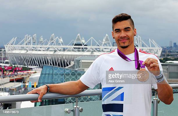 Louis Smith of Team GB with his bronze medal at the adidas Olympic Media Lounge at Westfield Stratford City on July 31 2012 in London England