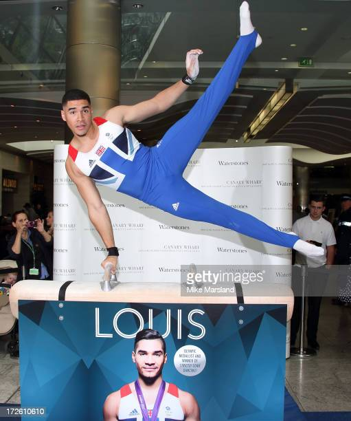 Louis Smith performs on a pommel horse during the signing of his new book 'Louis My Story So Far' at Waterstones Canary Wharf on July 4 2013 in...