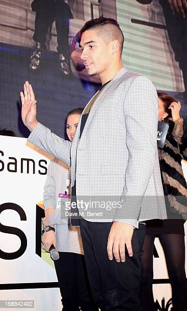 Louis Smith plays at the Samsung Smart TV Angry Birds Party at Westfield Stratford City on December 13 2012 in London England