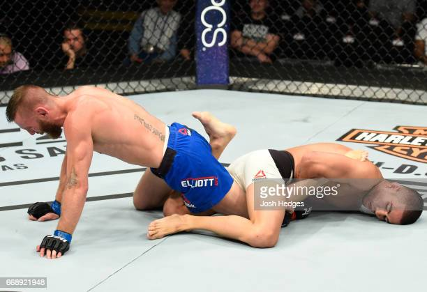 Louis Smolka attempts to submit Tim Elliott in their flyweight fight during the UFC Fight Night event at Sprint Center on April 15 2017 in Kansas...
