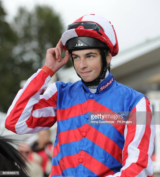 Louis Steward celebrates on Mutual Regard after winning the Betfred Ebor on Betfred Ebor Day during Day Four of the 2014 Welcome To Yorkshire Ebor...