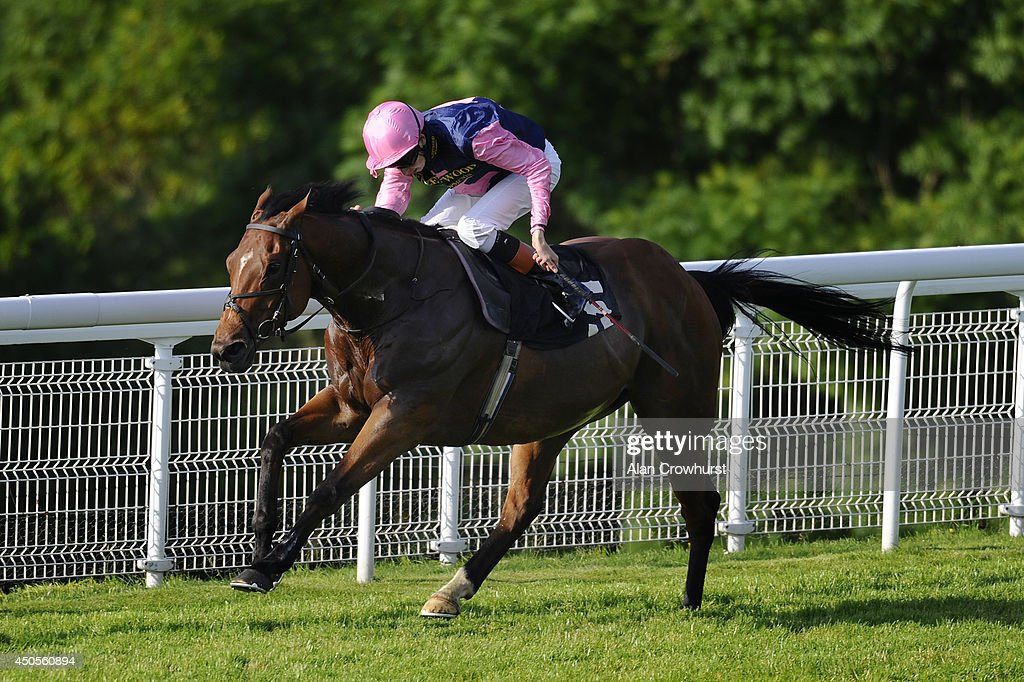 Louis Steward riding Brave Echo win The Naughty Boy Apprentice Stakes at Goodwood racecourse on June 13, 2014 in Chichester, England.