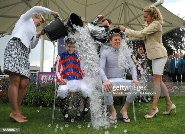 Louis Steward the winning jockey and Johnny Murtagh the winning trainer of the Ebor winner Mutual Regard take part in the 'Ice Bucket Challenge' on...