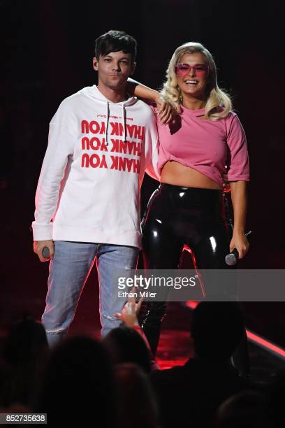 Louis Tomlinson and Bebe Rexha perform onstage during the 2017 iHeartRadio Music Festival at TMobile Arena on September 23 2017 in Las Vegas Nevada