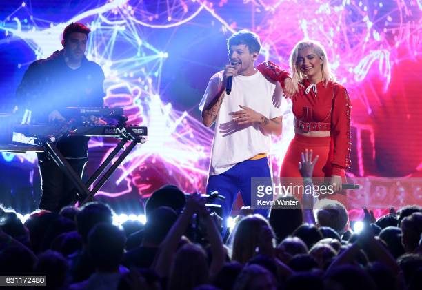 Louis Tomlinson and Bebe Rexha perform onstage during the Teen Choice Awards 2017 at Galen Center on August 13 2017 in Los Angeles California