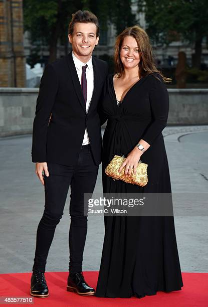 Louis Tomlinson and Johannah Poulston attend the Believe in Magic Cinderella Ball at Natural History Museum on August 10 2015 in London England