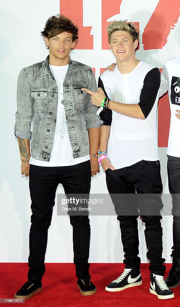 Louis Tomlinson (L) and Niall Horan of One Direction attend a photocall to launch their new film 'One Direction: This Is Us 3D' at Big Sky Studios on August 19, 2013 in London, England.