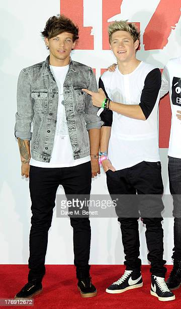 Louis Tomlinson and Niall Horan of One Direction attend a photocall to launch their new film 'One Direction This Is Us 3D' at Big Sky Studios on...
