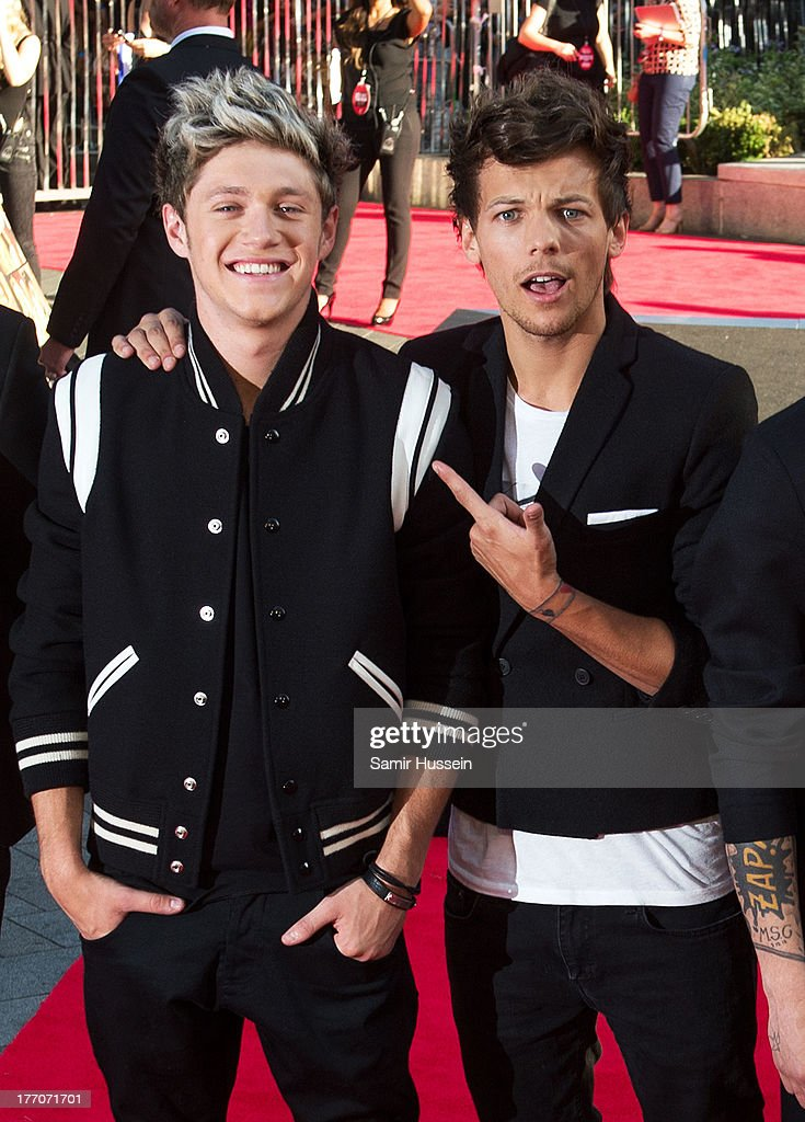 Louis Tomlinson and Niall Horan (L) of One Direction attend the World Premiere of 'One Direction: This Is Us' at Empire Leicester Square on August 20, 2013 in London, England.