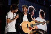 Louis Tomlinson and Niall Horan of One Direction perform onstage during the 'Where We Are' tour at Met Life Stadium on August 4 2014 in New York City