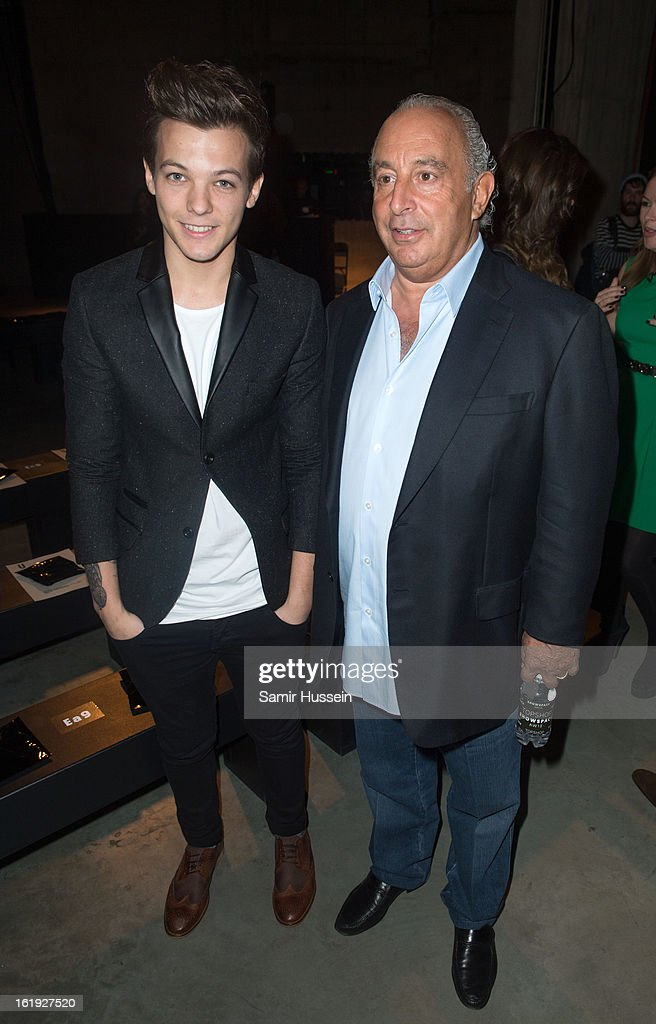 Louis Tomlinson from One Direction and Philip Green attend the Topshop Unique show at the Tate Modern during London Fashion Week Fall/Winter 2013/14 on February 17, 2013 in London, England.