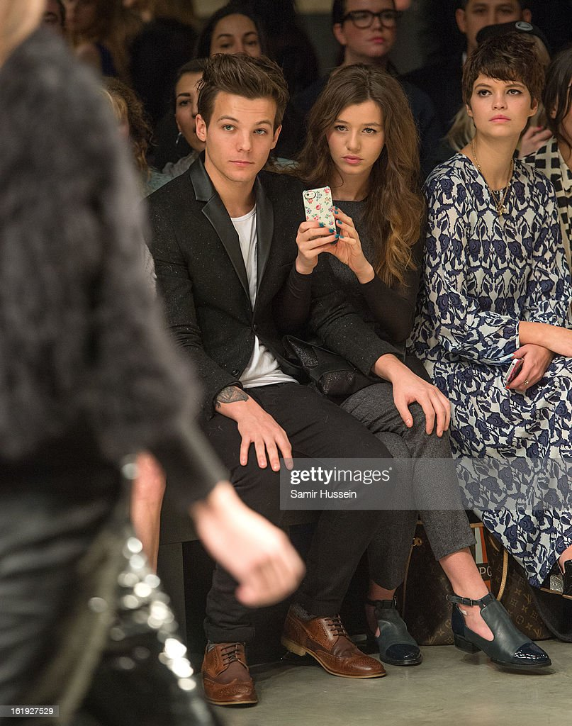 Louis Tomlinson from One Direction, Eleanor Calder and Pixie Geldof attend the Topshop Unique show at the Tate Modern during London Fashion Week Fall/Winter 2013/14 on February 17, 2013 in London, England.