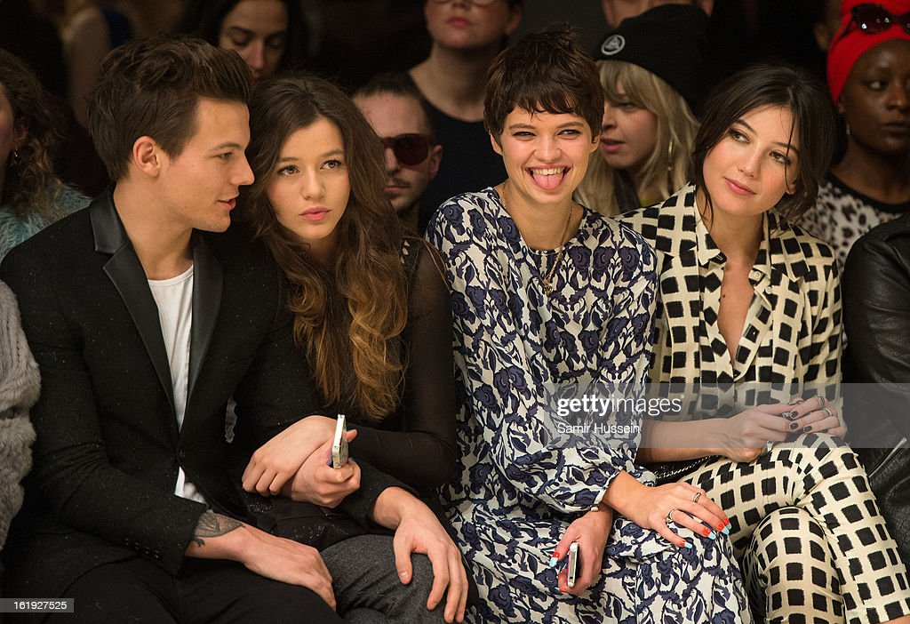 Louis Tomlinson from One Direction, Eleanor Calder, Pixie Geldof and Daisy Lowe attend the Topshop Unique show at the Tate Modern during London Fashion Week Fall/Winter 2013/14 on February 17, 2013 in London, England.