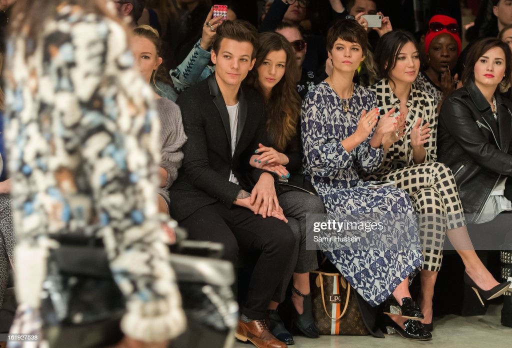 Louis Tomlinson from One Direction, Eleanor Calder, Pixie Geldof , Daisy Lowe and Demi Lovato attend the Topshop Unique show at the Tate Modern during London Fashion Week Fall/Winter 2013/14 on February 17, 2013 in London, England.