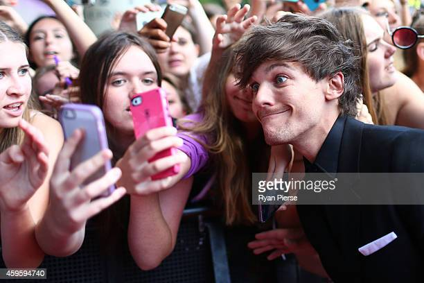 Louis Tomlinson from One Direction poses with fans at the 28th Annual ARIA Awards 2014 at the Star on November 26 2014 in Sydney Australia
