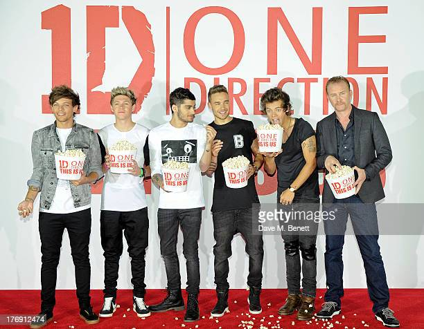 Louis Tomlinson Niall Horan Zayn Malik Liam Payne and Harry Styles of One Direction pose with director Morgan Spurlock at a photocall to launch their...