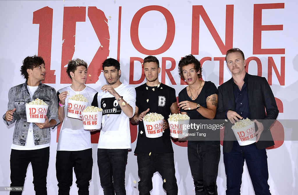 Louis Tomlinson, Niall Horan, Zayn Malik, Liam Payne and Harry Styles of One Direction with Morgan Spurlock attend a photocall to launch their new film 'One Direction: This Is Us 3D' held at the Blue Sky Studios on August 19, 2013 in London, England.