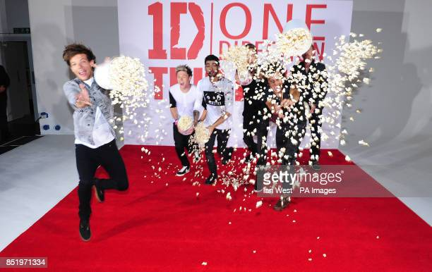 Louis Tomlinson Niall Horan Zayn Malik Liam Payne and Harry Styles from One Direction with Morgan Spurlock are seen at a photocall to promote their...