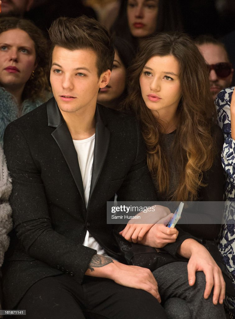 <a gi-track='captionPersonalityLinkClicked' href=/galleries/search?phrase=Louis+Tomlinson&family=editorial&specificpeople=7235196 ng-click='$event.stopPropagation()'>Louis Tomlinson</a> of One Direction and Eleanor Calder attend the Topshop Unique show at the Tate Modern during London Fashion Week Fall/Winter 2013/14 on February 17, 2013 in London, England.