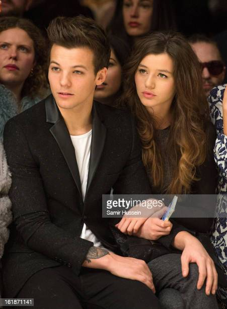 Louis Tomlinson of One Direction and Eleanor Calder attend the Topshop Unique show at the Tate Modern during London Fashion Week Fall/Winter 2013/14...