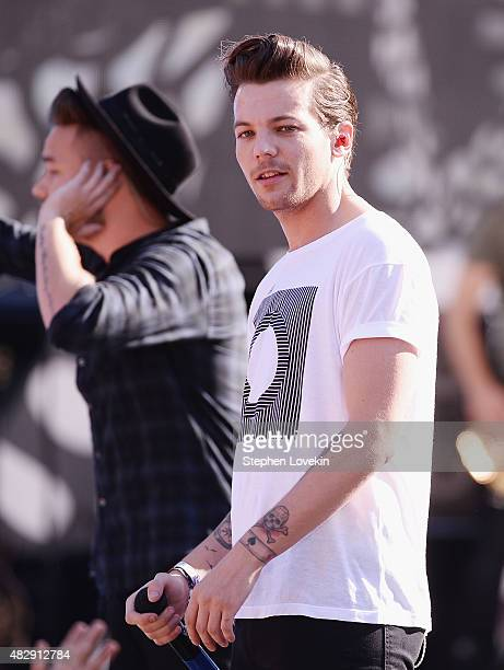 Louis Tomlinson of One Direction performs on ABC's 'Good Morning America' at Rumsey Playfield Central Park on August 4 2015 in New York City
