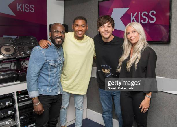 Louis Tomlinson poses with KISS FM Presenters Charlie Hedges Rickie HaywoodWilliams and Melvyn Odoom at Kiss FM Studio's on July 19 2017 in London...