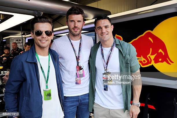 Louis Tomlinson singer Michael Carrick football player and Dan Carter rugby player outside the Red Bull Racing garage before qualifying for the...
