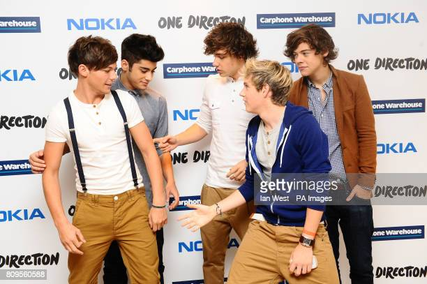 Louis Tomlinson Zayn Malik Liam Payne Harry Styles and Niall Horan of One Direction launch their new Nokia handsets at the Carphone Warehouse in...