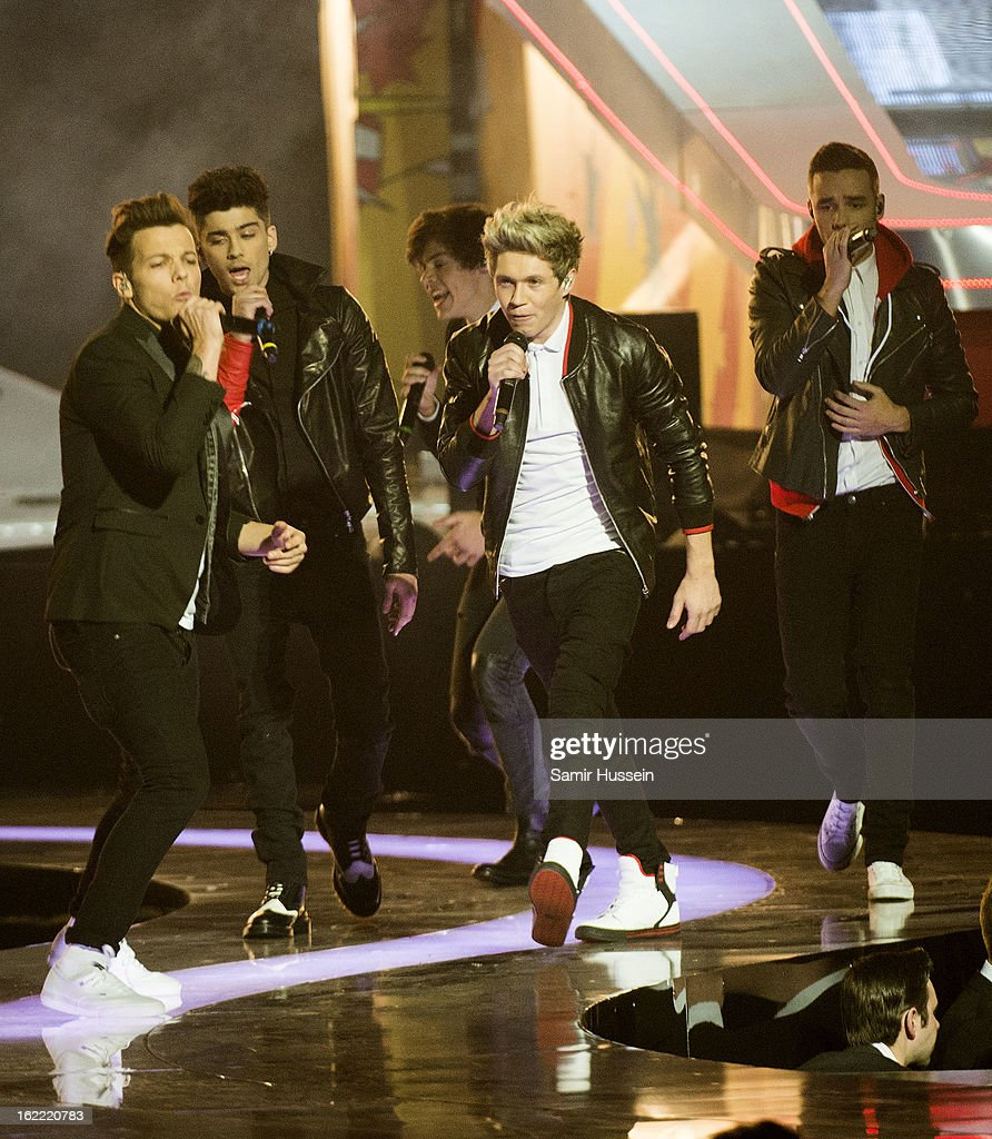 Louis Tomlinson, Zayn Malik, Niall Horan, Harry Styles and Liam Payne of One Direction perform during the Brit Awards 2013 at 02 Arena on February 20, 2013 in London, England.