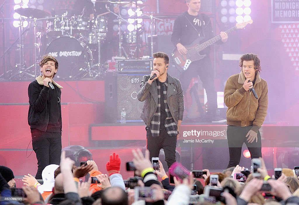 Louis Tomlinson,Liam Payne and Harry Styles and of One Direction perform at Rumsey Playfield on November 26, 2013 in New York City.