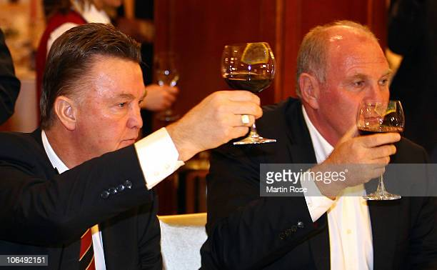 Louis van Gaal head coach of Bayern Muenchen has a drink with Uli Hoeness president of Bayern Munich during the champions dinner at Opera Hotel on...