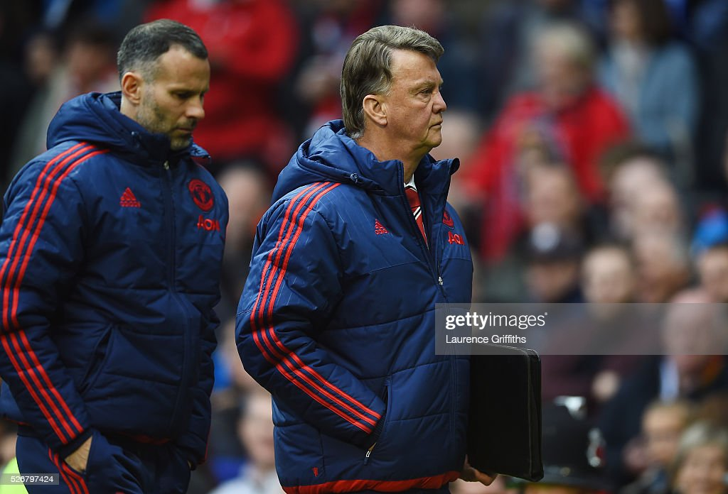Louis van Gaal, manager of Manchester United and assistant Ryan Giggs walk in for half time during the Barclays Premier League match between Manchester United and Leicester City at Old Trafford on May 1, 2016 in Manchester, England.