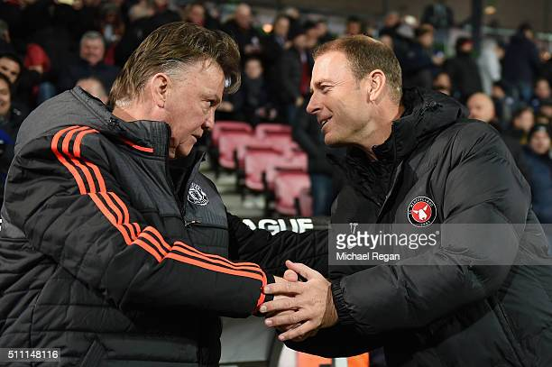 Louis van Gaal Manager of Manchester United and Jess Thorup manager of FC Midtjylland shake hands prior to the UEFA Europa League round of 32 first...