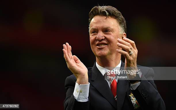 Louis van Gaal manager of Manchester United applauds the crowd after the Barclays Premier League match between Manchester United and Arsenal at Old...