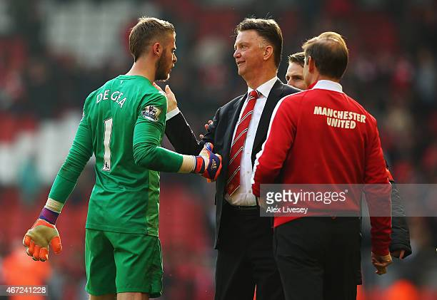 Louis van Gaal manager of Manchester United celebrates victory with David De Gea of Manchester United after the Barclays Premier League match between...