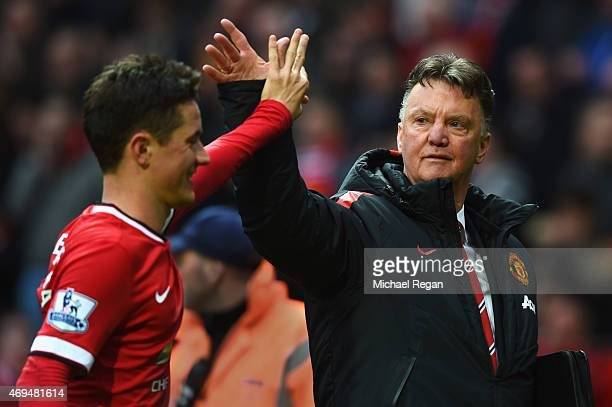 Louis van Gaal manager of Manchester United celebrates victory with Ander Herrera after the Barclays Premier League match between Manchester United...